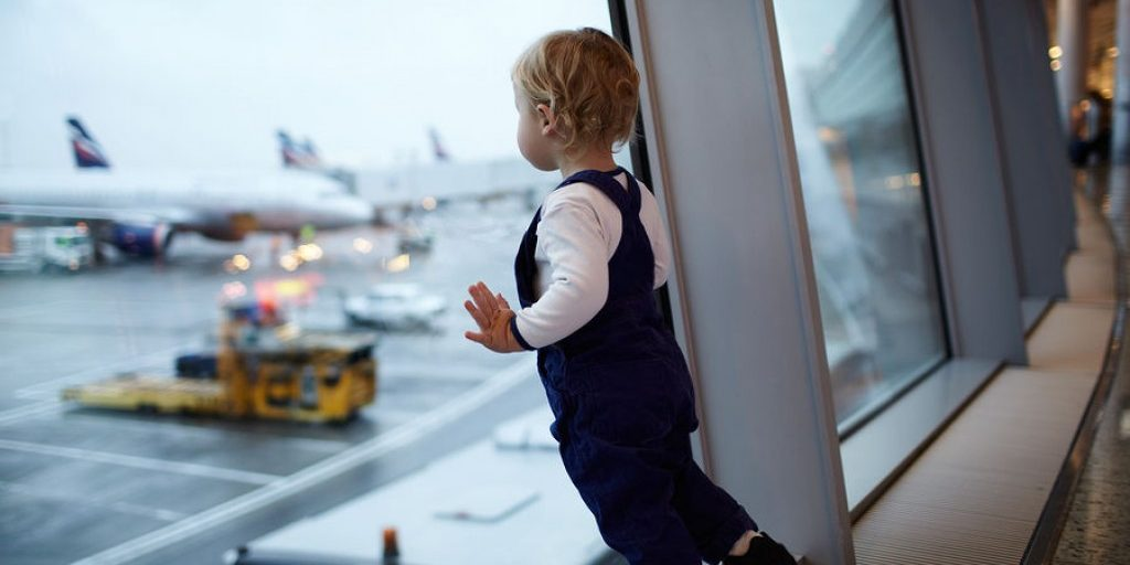 bigstock-Kid-in-the-airport--41659252
